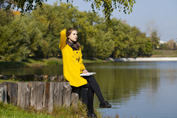 Beautiful young woman in yellow coat