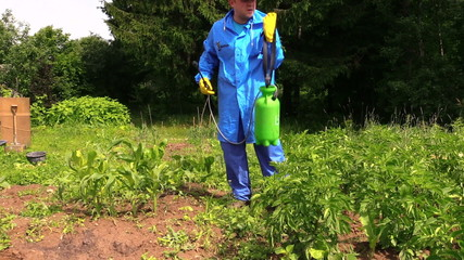Farmer man in waterproof clothes prepare pesticides chemicals