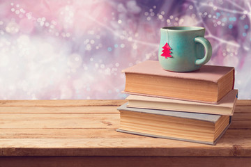 Christmas cup of tea and vintage books on wooden table