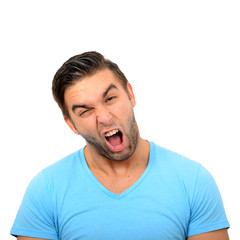 Portrait of angry man screaming against white background