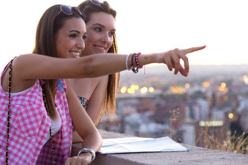 Pretty girls looking at the views in the city.