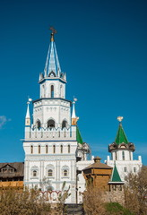 Russian fortress with colorful ornate towers and weathervanes