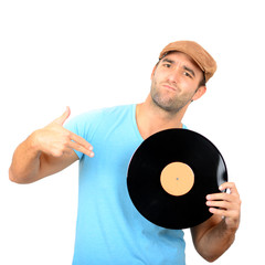 Portrait of handsome DJ holding vinyl against white background