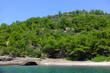 Leinwanddruck Bild - Green hills by the sea