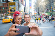 canvas print picture - Young Couple Taking Selfie in Times Square