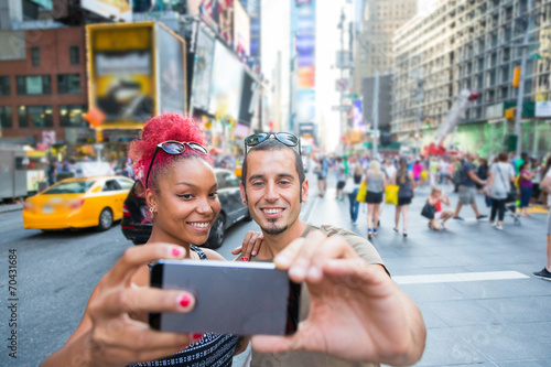 canvas print picture Young Couple Taking Selfie in Times Square