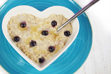 Blueberry Porridge or Oatmeal in a heart shaped bowl.