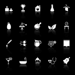 Spa treatment icons with reflect on black background