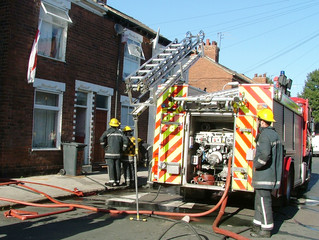 fire  fighter at house fire