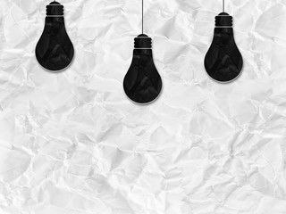 black bulb silhouette on white crumpled paper