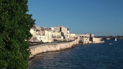 Quay of Ortygia island with Maniace  castle. Syracuse
