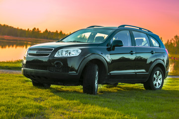 SUV - Black car with sunset background