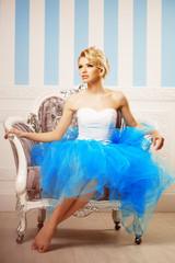 Dancer, ballerina. Cute woman looks like a doll in a sweet inter