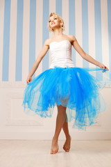Dancer, ballerina. Cute woman looks like a doll in a sweet inter