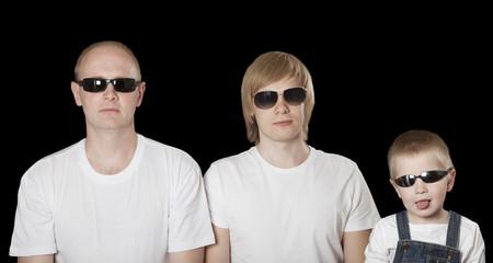 Three blonde males in sunglasses over black