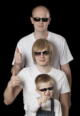 Father and sons giving thumbs up sign