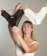 Woman hanging out her washing to dry