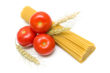 Tomatoes, spaghetti and wheat ears on white background