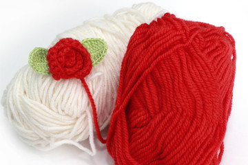 Red and white skein with crochet rose