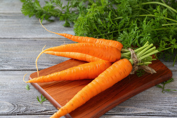 bunch of fresh carrots on the board