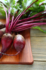 bunch of fresh beets on a cutting board