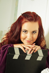 Actress with clapper board