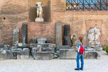 Female tourist looks at the ruins of Diocletian Baths, Rome