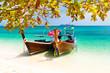 Leinwanddruck Bild - Wooden boats on a tropical beach.