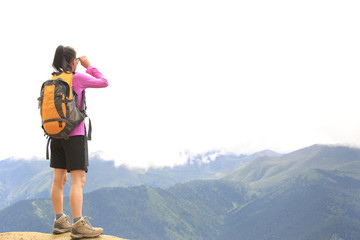 young woman hiker  enjoy the view mountain peak