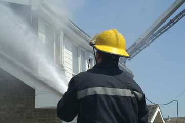 fire fighter fighting house fire