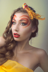 Studio beauty portrait with yellow bird. Art concept
