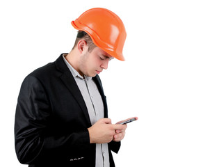 Man wearing a hardhat checking his mobile