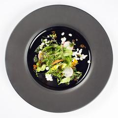Salad on black plate