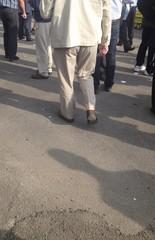 elderly man in linen suit walking