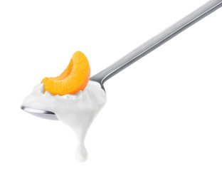Spoon of peach yogurt isolated on white