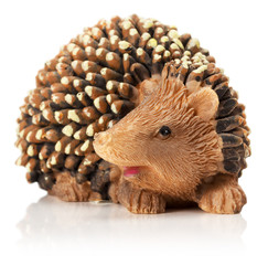 hedgehog figurine isolated on the white background
