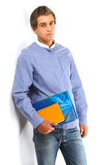 Young college guy  holding a books