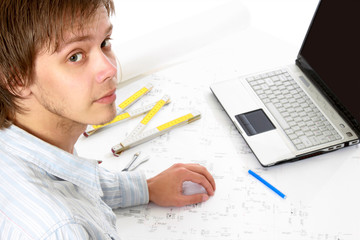 Portrait of young architect at his workplace