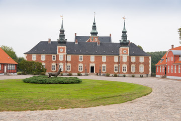 Old castle tower, statue and courtyard in Jægerspris, Denmark