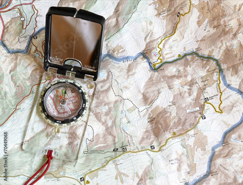 Foto op Canvas Kamperen Navigating with map and compass, essential backcountry skills