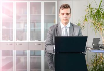 Business man at computer desk