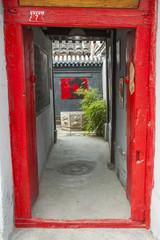 Mao portrait in a courtyard