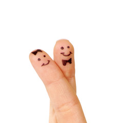 Painted couple of finger smiley isolated on white
