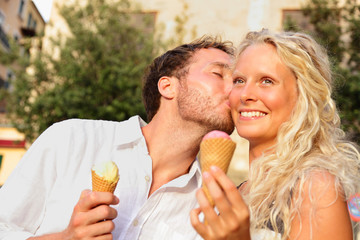 Couple eating ice cream kissing happy