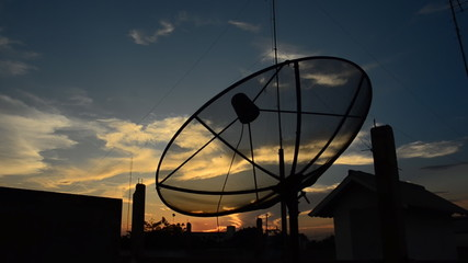 Satellite Dish with and cloud background at sunset. HD