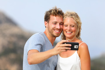 Selfie with smartphone - couple self-portrait