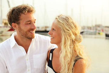 Happy young couple in yacht harbor marina port