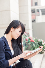 young asian woman with laptop