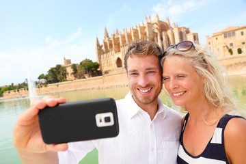 Happy couple dating taking selfie photo, Mallorca