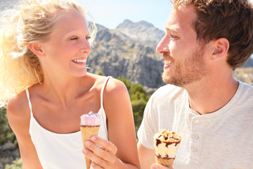 Happy couple eating ice cream cone